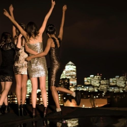 group-of-young-women-standing-on-a-rooftop-celebra-LMESHHM